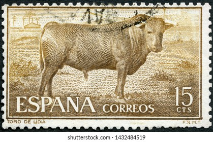 MOSCOW, RUSSIA - MAY 31, 2019: A stamp printed in Spain shows Lidian Bull, corrida, Fighting with muleta, 1960