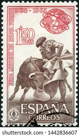 MOSCOW, RUSSIA - MAY 31, 2019: A stamp printed in Spain shows Fighting with cape, Bullfight and Unisphere, corrida, New York World Fair, 1964-65, 1964
