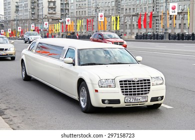 MOSCOW, RUSSIA - MAY 5, 2012: White limousine Chrysler 300C at the city street.
