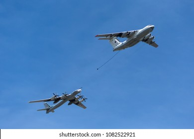 "Moscow, Russia - May 7, 2015: The Ilyushin Il-76 tanker and the Tupolev Tu-95 (NATO reporting name: ""Bear"") aircraft demonstrating the refueling of the aircraft in the air at Parade of Victory in WWII"