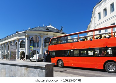 Moscow, Russia - May 7, 2018: Tourist red double-deck bus at Gostiny Dvor, the old merchant court of Moscow located close to Red Square and new Zaryadie park