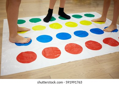 MOSCOW, RUSSIA - MAY 8, 2015: Children play Twister game in room. Twister is a game of physical skill produced by Milton Bradley Company and Winning Moves.
