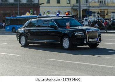 Moscow / Russia - May 8, 2018: President Vladimir Putin drives through the street of Tverskaya in Moscow in his Aurus Senat Presidential limousine