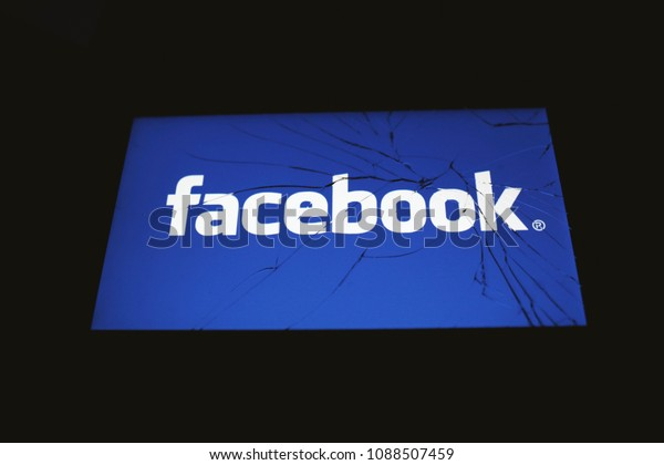 Moscow, Russia - May, 8 2018: The logo of Facebook is displayed on a smartphone with splintered glass.