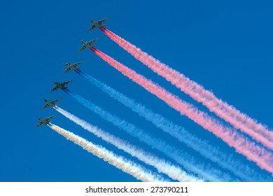 Moscow, Russia - May 9, 2014: A group of aircraft in-flight smoke color Russian flag at Parade of Victory in World War II on May 9, 2014 in Moscow.