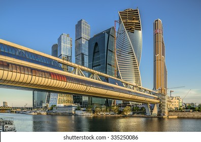 Moscow, Russia - May 9, 2014: Pedestrian bridge Bagration on the background of buildings Business Center Moscow City.