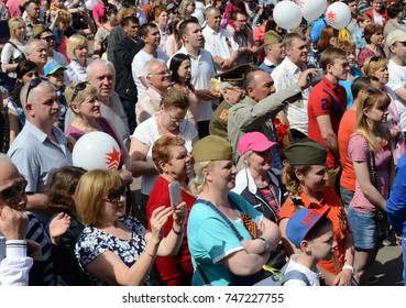 MOSCOW, RUSSIA - MAY 9, 2016:People during the celebration of Victory Day are watching a concert at the Exhibition of Economic Achievements.