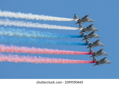 MOSCOW, RUSSIA - MAY 9, 2018: Russian Air Force Sukhoi Su-25 jets fly in formation and leave a trail in the Russian national colours during 9 May military parade.