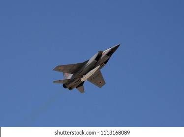 """MOSCOW, RUSSIA MAY 9, 2018: The modernized fighter-interceptor MiG-31 with hypersonic missiles """"Dagger"""", fixed in the lower point of the hull, flying in the sky over red square during the parade."""
