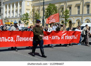 MOSCOW, RUSSIA  MAY 9, 2018: The column of the Communist party is in the center of Moscow at a demonstration dedicated to the Victory Day.
