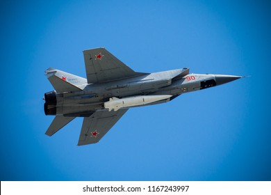 MOSCOW, RUSSIA – MAY 9, 2018: Russian supersonic interceptor MiG-31 aircraft with the Kh-47M2 Kinzhal (Dagger) air-launched hypersonic missile during parade. Can be equipped with a nuclear warhead.