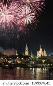 Moscow, Russia, May 9, 2019. View of the night city and bright colorful fireworks over the Moscow Kremlin