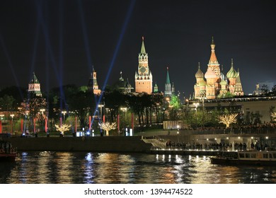 Moscow, Russia, May 9, 2019. Beautiful night view from the river to the Moscow Kremlin illuminated by floodlights and soaring bridge