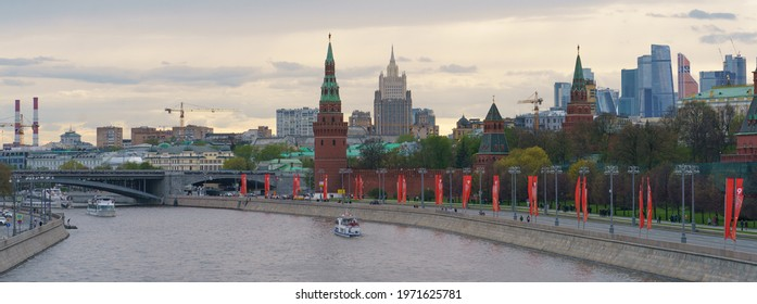 Moscow, Russia - May 9, 2021:  Celebration of the Victory. Red Kremlin Towers, Moskva River, Bolshoy Kamenny Bridge, traffic, Stalinist architecture, modern MIBC (Moscow International Business Center)