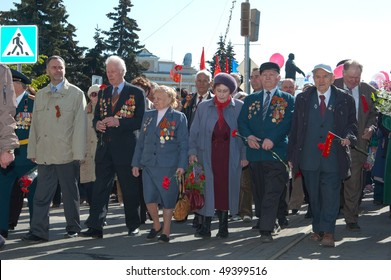MOSCOW, RUSSIA - MAY 9: A group of veterans go on the Red Square on Victory Day celebration, May 9, 2009 in Moscow, Russia.