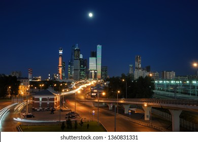 MOSCOW, RUSSIA - Modern Skyscrapers of Moskva-City in Moonlight. The view from Zvenigorodskoye Shosse (Highway) on the Moscow International Business Centre (MIBC) in twilight.