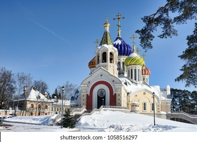 MOSCOW, RUSSIA - Neo-Russian style Church of the Holy Igor of Chernigov in Peredelkino, South-West suburb of Moscow, with beautiful and unique porcelain onion-shaped domes framed by a tree in winter.