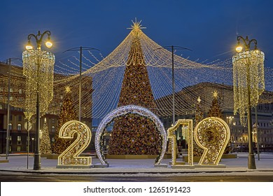 MOSCOW, RUSSIA - New Year sign 2019 framed with decorated street lamps and amazing Christmas trees under a tent of garlands fulfilled with thousands of LED lights on Lubyanka square.