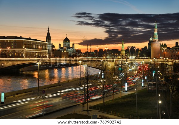 MOSCOW, RUSSIA - Night cityscape of Moscow from park Zaryadye with traffic lights on Moskvoretskaya embankment, Moscow River) reflections and illuminated Bolshoi Moskvoretsky Bridge at sunset.