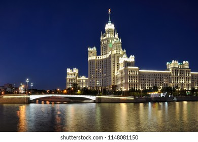 MOSCOW, RUSSIA - Night view of the illuminated Stalinist high-rise residential building on Kotelnicheskaya embankment of Moskow River in the summer dusk.
