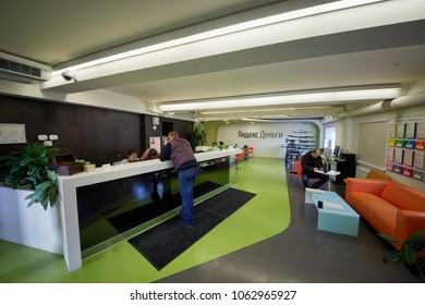 MOSCOW, RUSSIA - NOV 09, 2017: People in Yandex Money department in main Yandex office. Yandex.Money is an electronic payment service.