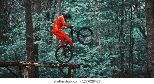 Moscow, Russia - Nov, 2018: Jump and fly on a mountain bike. Rider in action at mountain bike sport. Biker making a stunt and step down jumping. Cool athlete cyclist on a bike. MTB biking.