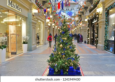 MOSCOW, RUSSIA - NOV 25, 2018: Christmas and New Year. Tourists among Lovely two-meter Christmas trees at State Department Store