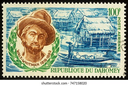 Moscow, Russia - November 02, 2017: A stamp printed in Dahomey shows portrait of American poet Walt Whitman (1819-1892), circa 1970