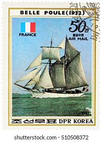 "MOSCOW, RUSSIA - NOVEMBER 04, 2016: A stamp printed in DPRK (North Korea) shows image of French sail training ship ""Belle Poule"" (1932) and French flag, series ""Sailing Ships"", circa 1987"