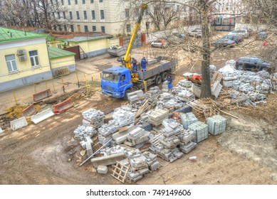 MOSCOW, RUSSIA - November 04.2017: Team of construction workers loads in car building blocks