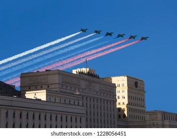MOSCOW, RUSSIA – NOVEMBER 05, 2018: Main Building of the Ministry of Defence of the Russian Federation and Russian military aircrafts fly in formation, Moscow, Russia