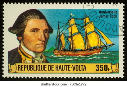 """Moscow, Russia - November 07, 2017: A stamp printed in Upper Volta shows Captain James Cook and his ship """"Resolution"""", series """"The 250th Anniversary of the Birth of James Cook, 1728-1779"""", circa 1978"""