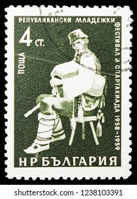 MOSCOW, RUSSIA - NOVEMBER 10, 2018: A stamp printed in Bulgaria shows Bagpiper, ‭7th International Youth Festival, Vienna serie, circa 1959