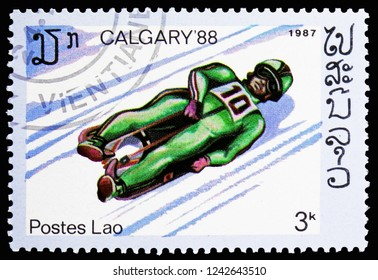 MOSCOW, RUSSIA - NOVEMBER 10, 2018: A stamp printed in Laos shows Luge, Olympics serie, circa 1987