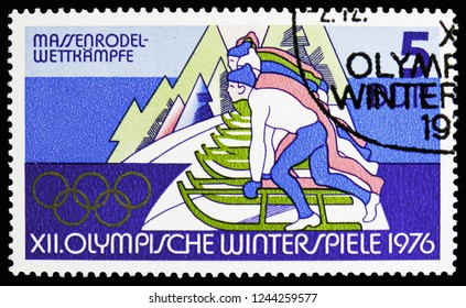 MOSCOW, RUSSIA - NOVEMBER 10, 2018: A stamp printed in Germany, Democratic Republic shows Luge, Winter Olympics 1976, Innsbruck serie, circa 1975