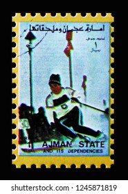 MOSCOW, RUSSIA - NOVEMBER 10, 2018: A stamp printed in Ajman shows Slalom, Winter Olympics serie, circa 1973