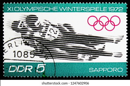 MOSCOW, RUSSIA - NOVEMBER 10, 2018: A stamp printed in Germany, Democratic Republic shows Luge, Winter Olympics 1972, Sapporo serie, circa 1971