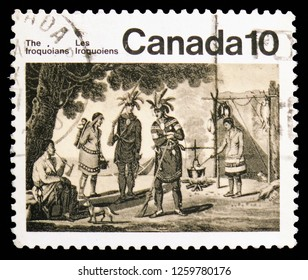 MOSCOW, RUSSIA - NOVEMBER 10, 2018: A stamp printed in Canada shows Iriquoian Encampment, Native Amerindians of Canada serie, circa 1976