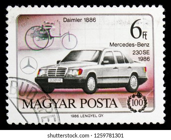 MOSCOW, RUSSIA - NOVEMBER 10, 2018: A stamp printed in Hungary shows Daimler 1886 and Mercedes-Benz 230SE, Centenary of cars serie, circa 1986