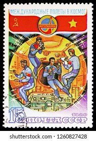 MOSCOW, RUSSIA - NOVEMBER 10, 2018: A stamp printed in USSR (Russia) shows Working aboard, Soviet-Vietnam Space Flight serie, circa 1980