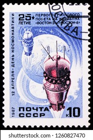 MOSCOW, RUSSIA - NOVEMBER 10, 2018: A stamp printed in USSR (Russia) shows Space ships Vostok-3 and 4 on the background of globe, Cosmonautics Day serie, circa 1987