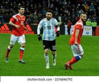 Moscow, Russia - November 11, 2017. Argentina national football team captain Lionel Messi and Russian players Alan Dzagoev Fedor Kudryashov during international friendly against Russia in Moscow.