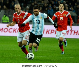 Moscow, Russia - November 11, 2017. Argentina national football team captain Lionel Messi with Russian players Denis Glushakov and Daler Kuzyaev during Russia vs Argentina match.
