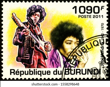 Moscow, Russia - November 12, 2019: stamp printed in Burundi shows portrait of Jimi Hendrix with guitar (1942-1970), American rock guitarist, singer, and songwriter, circa 2011