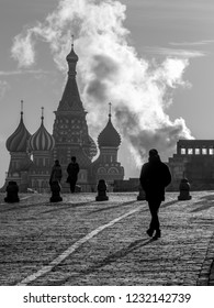 Moscow / Russia November 13 2018: Red Square in St Basil's Cathedral in background and man in silhouette