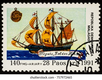 """Moscow, Russia - November 19, 2017: A stamp printed in Madagascar shows sailing ship, frigate """"Golden Hind"""" of Francis Drake, series """"Discovery of America"""", circa 1991"""