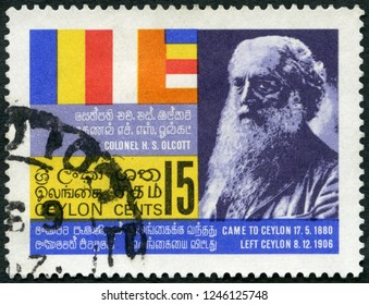 MOSCOW, RUSSIA - NOVEMBER 19, 2018: A stamp printed in Ceylon shows Colonel Henry Steel Olcott (1832-1907) and Buddhist flag, 1967