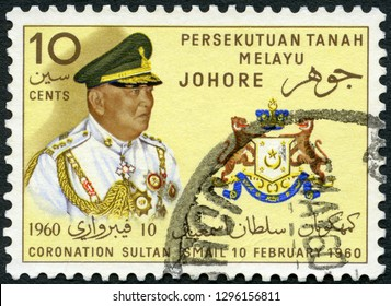 MOSCOW, RUSSIA - NOVEMBER 19, 2018: A stamp printed by Malaya shows Sultan Ismail and Johore State Crest Seal, Coronation of Sultan Sir Ismail di Johor (1895-1981), 1960