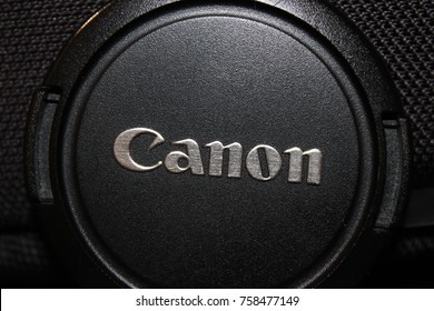 MOSCOW, RUSSIA - NOVEMBER 2, 2017: Canon Camera Lens with Cap Close Up. Canon is Japanese Multinational Corporation Selling Imaging and Optical Products, Mostly Known for Cameras and Photo Equipment.