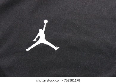 MOSCOW, RUSSIA - NOVEMBER 2, 2017: Air Jordan Brand White Logo on Black Shirt Background. Air Jordan is a Nike Company Brand of Basketball Footwear and Athletic Clothing, Created for Michael Jordan.